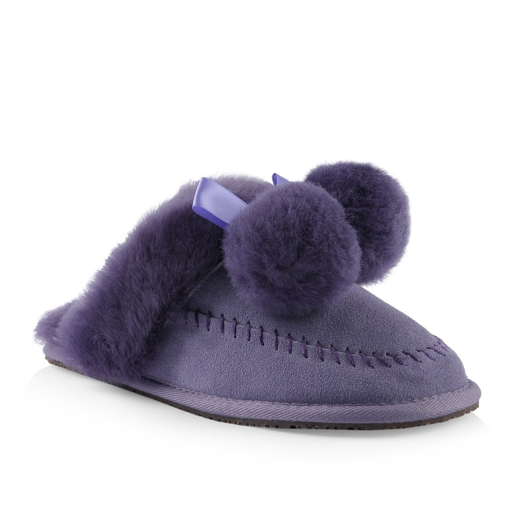 Nuknuuk leather slipper in violet with sheepskin pom poms and trim with a satin bow