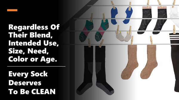 Regardless of the type of sock it deserves to be clean. Picture of differenty types of socks hanging on a clothes line