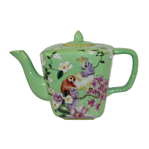 green teapot with parrot painting