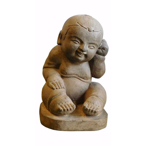 carved stone baby statue