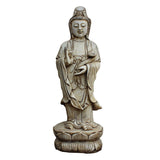white stone standing  Kwan Yin - Bodhisattva -  goddess of mercy - goddess of compassion