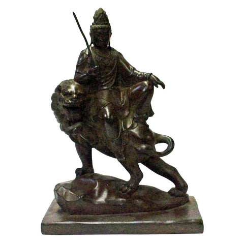 bronze Kwan Yin on lion - Bodhisattva -  goddess of mercy - goddess of compassion