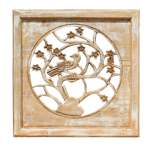 carved wood panel with bird and tree