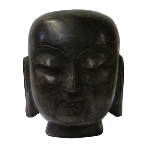 carved stone monk figure