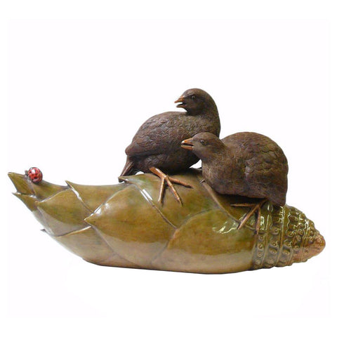 artist master piece ceramic bird on bamboo roots