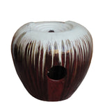 cream white and red round shape water fountain
