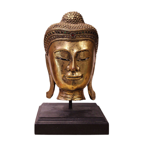 gold color Buddha head