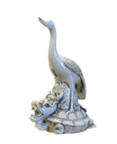 Asian porcelain turtle statue