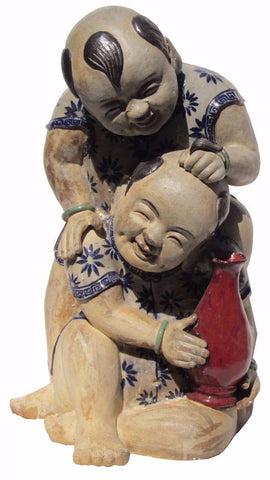 Chinese ceramic kid statue