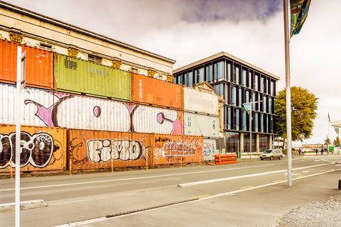 Containers, old building facade, new building