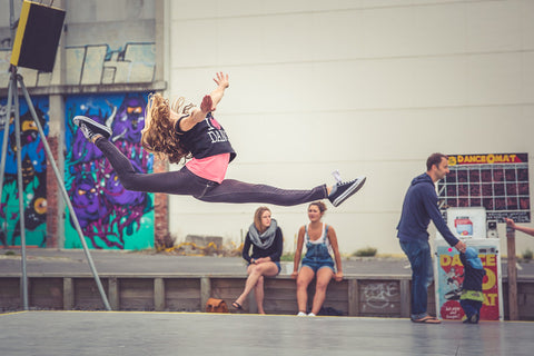 Girl doing a split leap