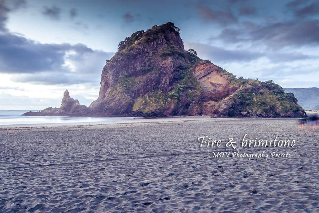 After lightroom preset 'Brimstone' applied - very large rock in the shape of a lion on the beach (Lion Rock, Piha Beach)