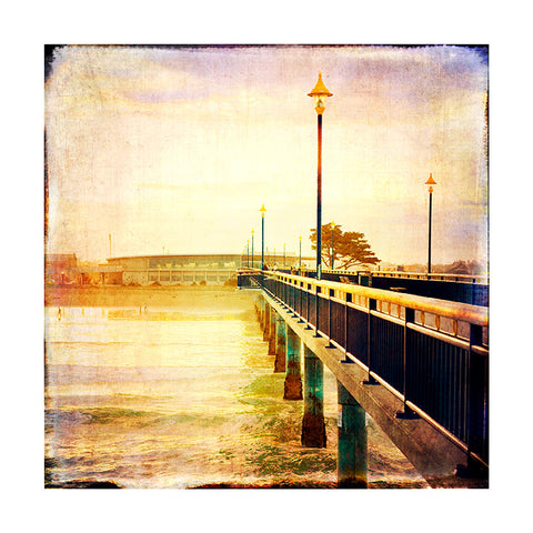 A textured photograph of the New Brighton Pier and Library.  Water, ocean, waves, sand.