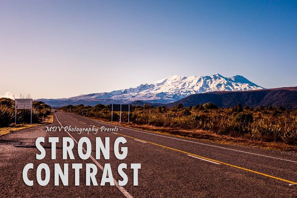 Strong Contrast lightroom preset header page - snow capped mountain in the distance, road in the foreground