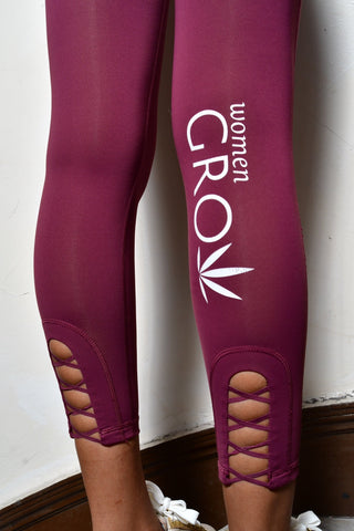 Maroon yoga pants with zipper on back, cross cross detail on back leg