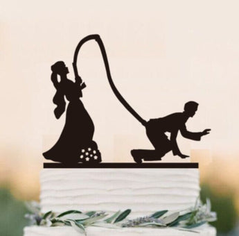 Bride hooking the groom wedding cake topper, funny party decor