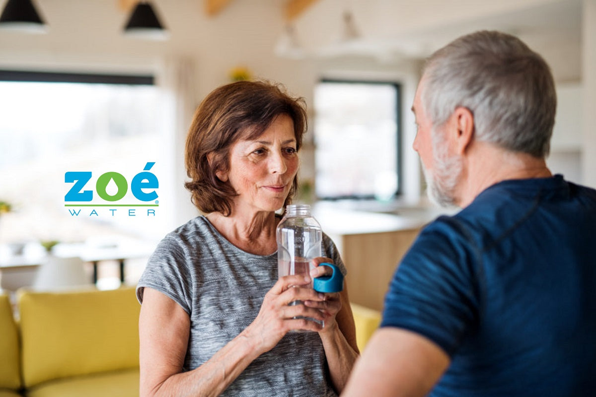 Older adult couple drinking alkaline water: Zoé Water USA