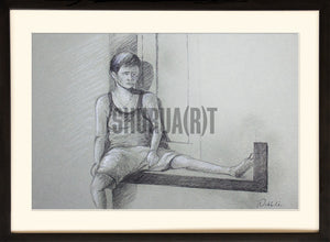 Boy sitting in a balcony