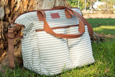 Hip Cub Weekender Tote leaning against a tree