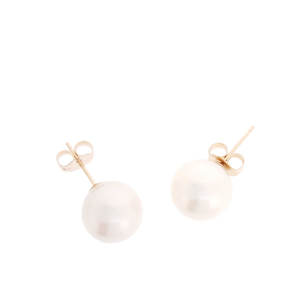 Round White Studs - The Courthouse Collection
