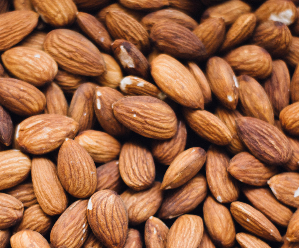 Almonds, nuts, plant ingredients, skincare formula, close-up, all natural