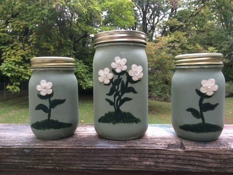 Set of 3 Hand Painted and lightly distressed Flower Jars. Mother of Pearl Flowers with center rhinestone adorn these lovely containers