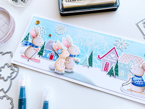 card scene with skiing bunnies