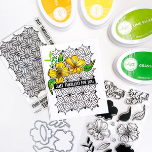 Yellow Dogwood flowers over black stamped prism background