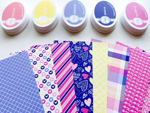 Happy Hearts Patterned Paper laid out with coordinating ink pads