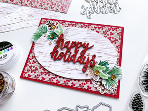 Pinecone Greetings around Happy Holidays diecut on patterned paper