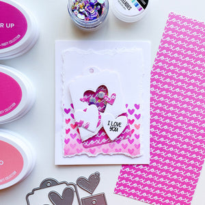 Heart shaker tag over heart patterned paper
