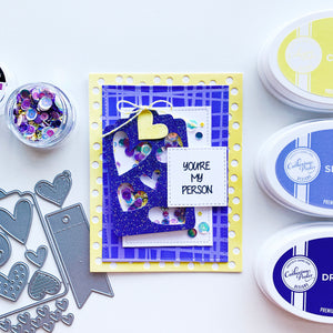 Hearts N Tags blue glitter cut out over patterned papers
