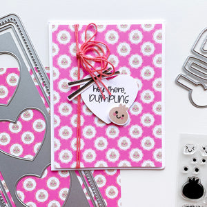 Dumpling patterned paper with heart and little dumpling on top