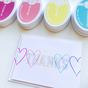Hip Hearts stamped in rainbow order with Thanks in glitter