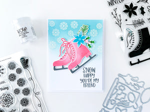 2 pink ice skates with blue blended background and snowflakes