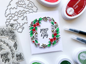 Peace Love and Holly garland ring on white card