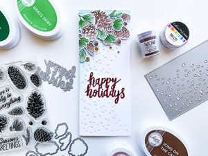 Pinecones layered over Flurries Slimline Background with Happy Holidays Senteiment