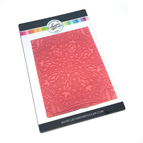 red rubber background stamp with lined images of gems and geometric patterns mixed with flowers to form a mandala.