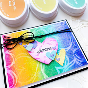 Scribbled Hearts rainbow glitter background with Hearts n Tags cut outs on top