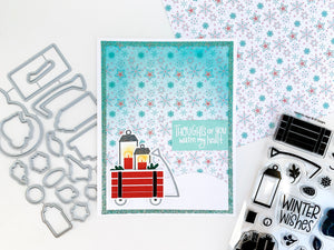Wagon with lanterns on a snowflake patterned paper