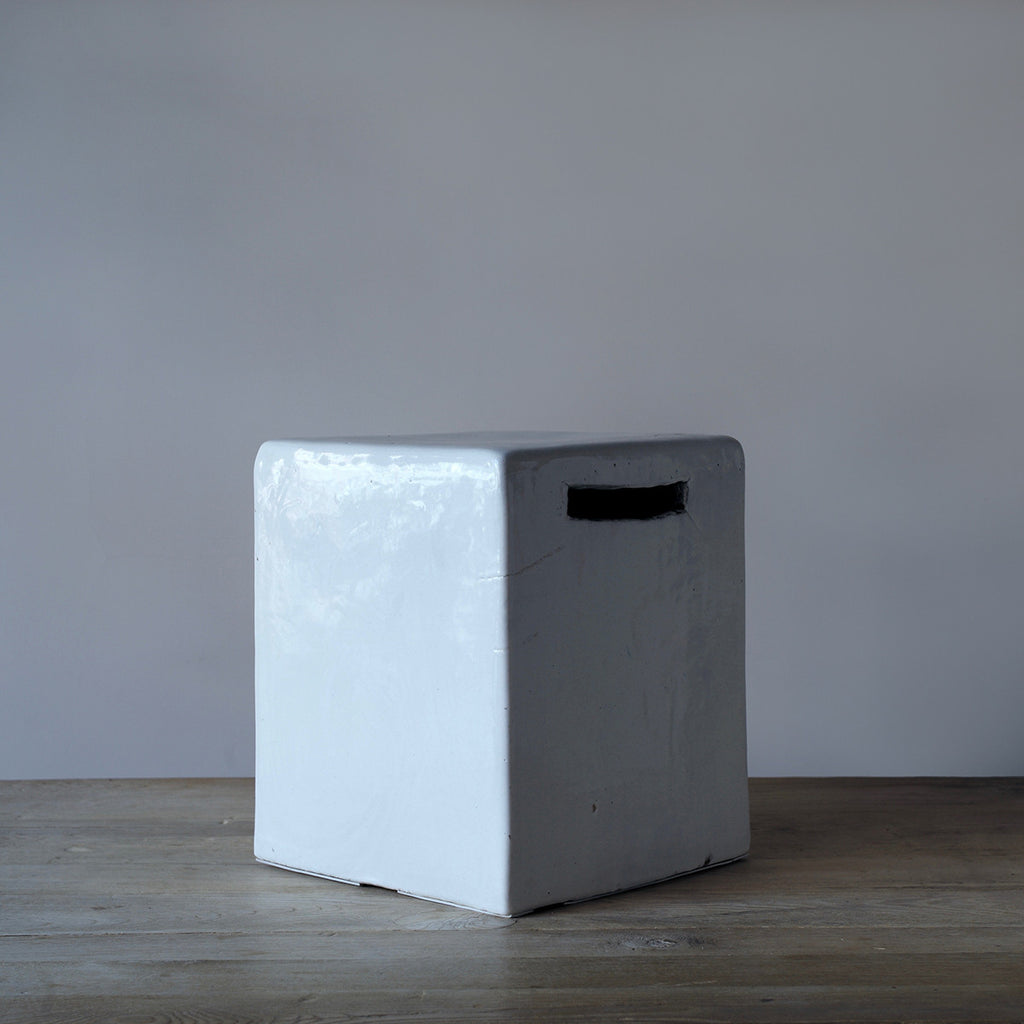 white ceramic stool / side table