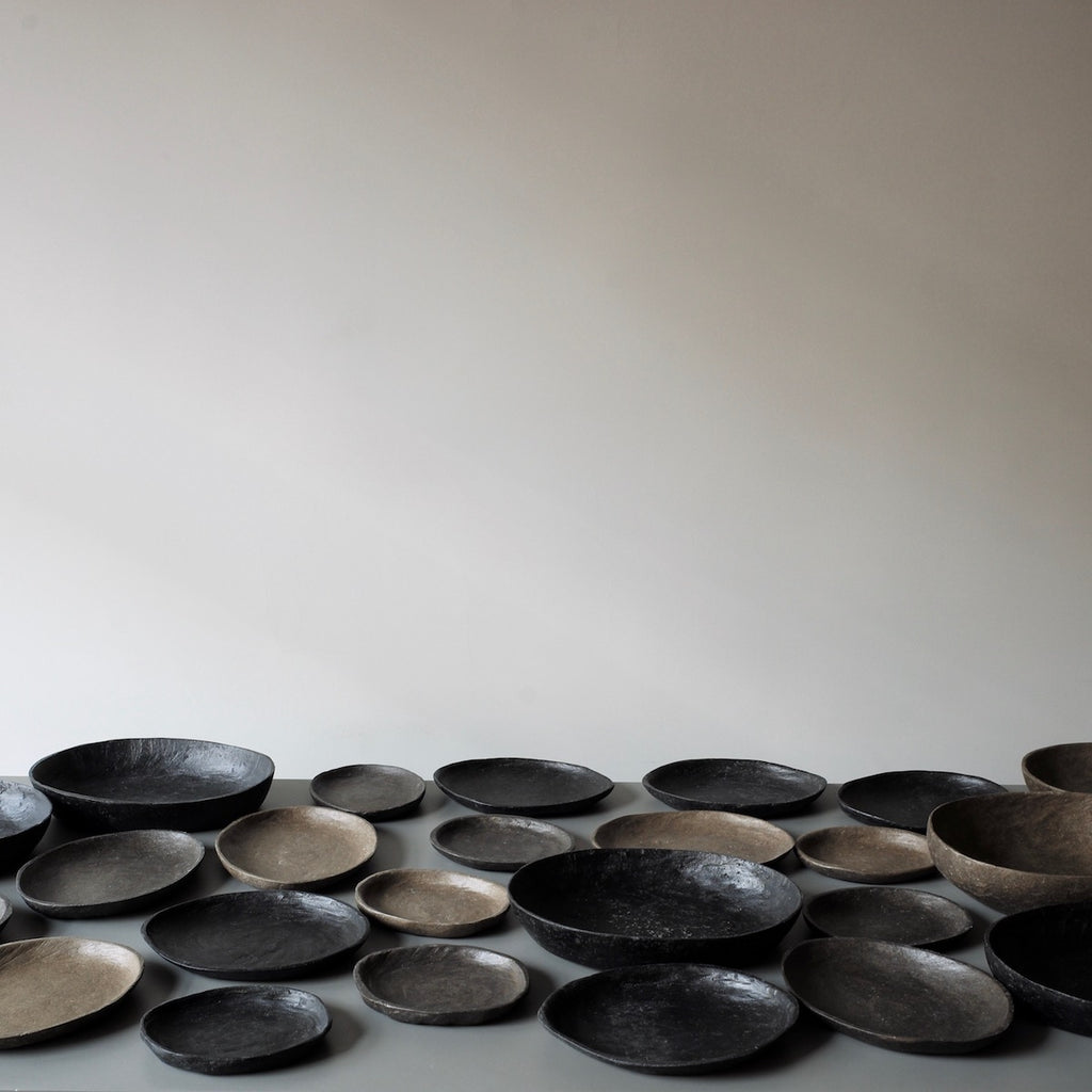 black pebble bowls and platters