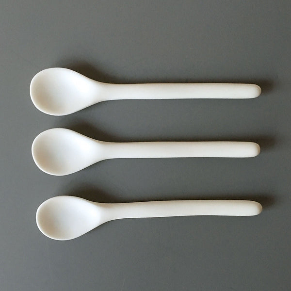 white resin spoons