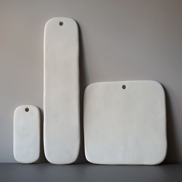 white resin serving boards