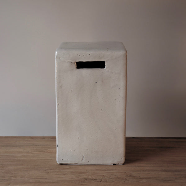 white tall ceramic stool