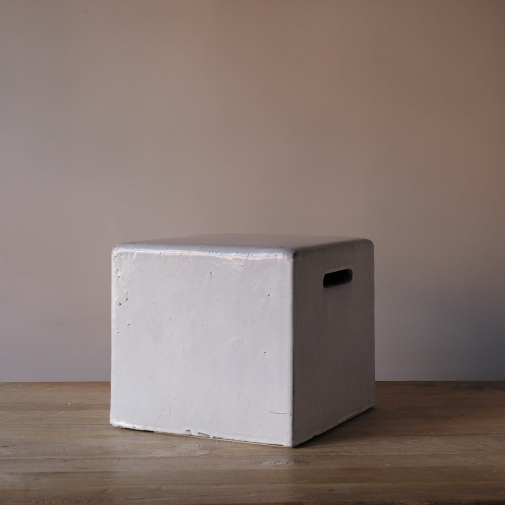 white short ceramic stool