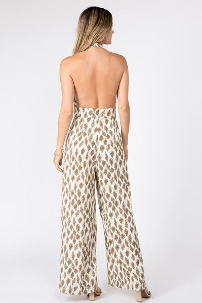 woman wearing a naked back printed jumpsuit