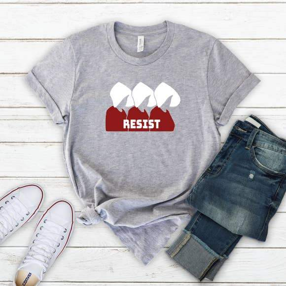 flatlay with womens grey printed tee, jeans and white sneakers