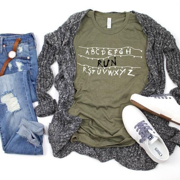 green printed shirt for women with grey cardigan and jeans flatlay