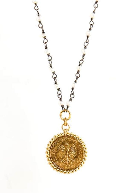 gold coin necklace on silver chain